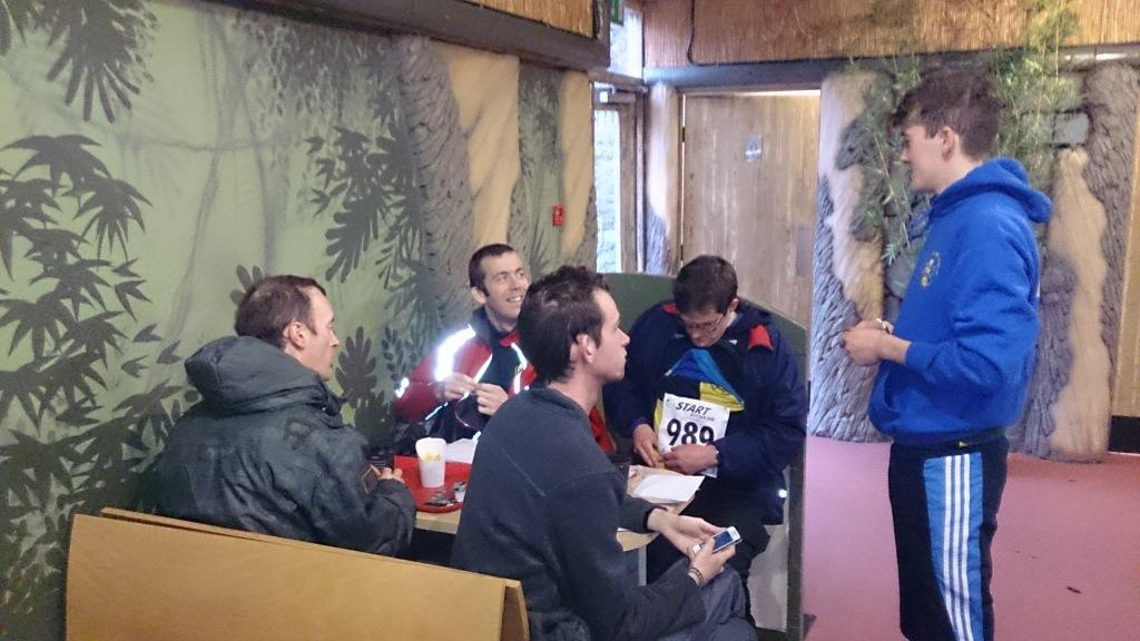 After running Rob gives details of conditions out on the course to the Senior Men, who are  wisely sheltering from the downpour in the cafe.