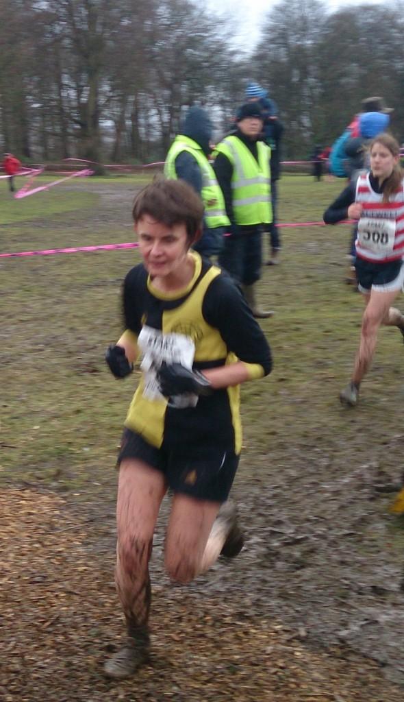 Caroline Warrington skipping over the mud