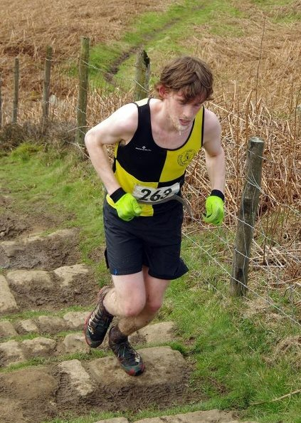 Harry Holmes giving it his all climbing out of Gribdale.